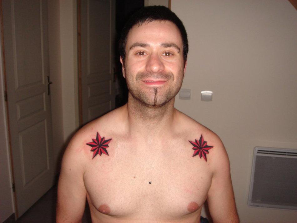 Татуировки на плечах значение 112