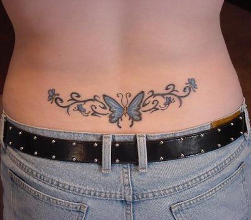 Татуировка на пояснице телки