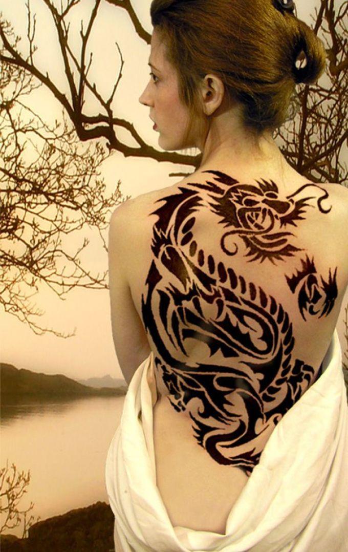 Фото тату дракон на спине у девушек