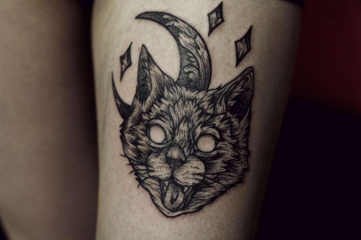 Татуировка кошка - символ ночи и луны