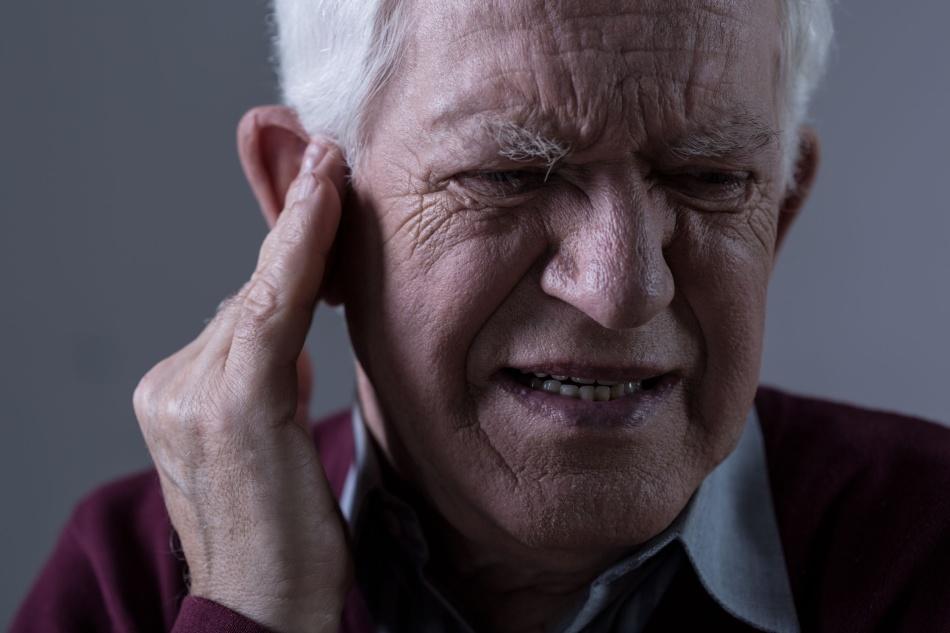 Звон в ушах и голове - признаки бруксизма