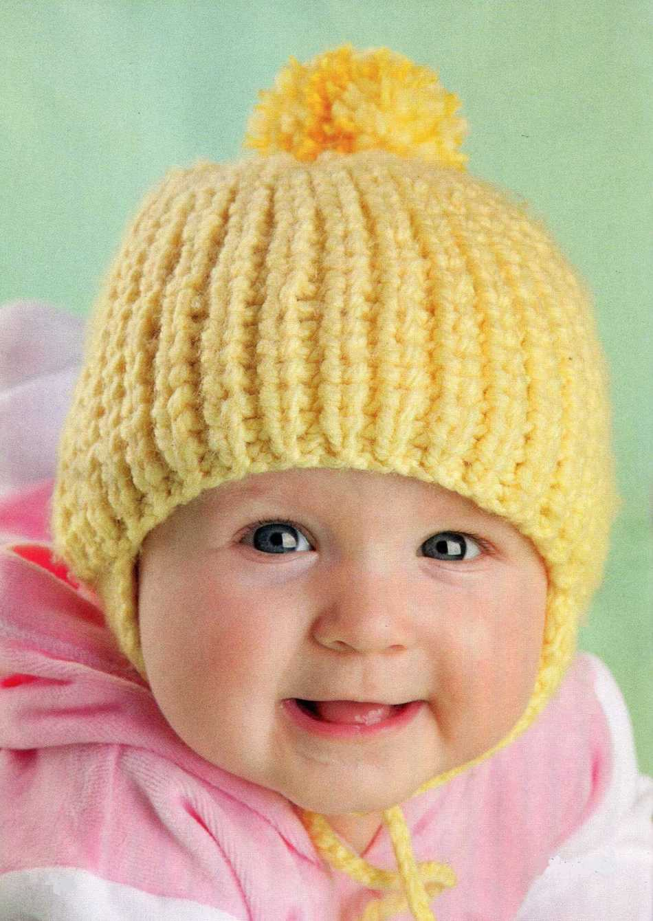6ec4068f0e14 Теплые вязаные детские шапки спицами для девочек зимние: схемы и описание.  Теплая желтая вязаная шапка на девочке. Теплая желтая вязаная шапка на  девочке